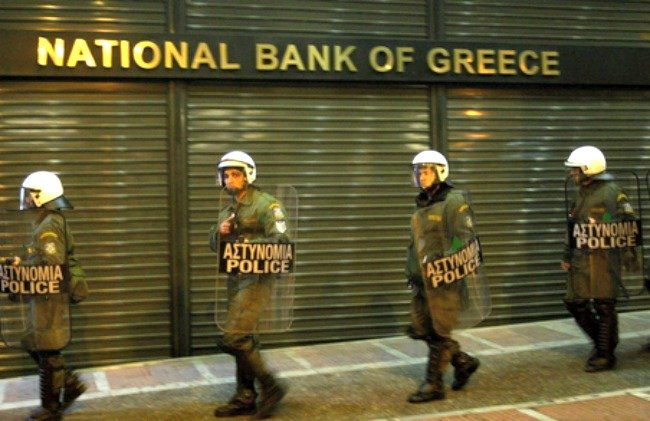 Riot police in front of National Bank of Greece