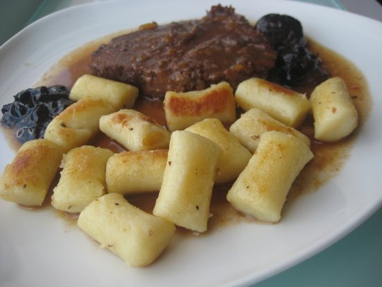 Pasticada with potato gnocchi
