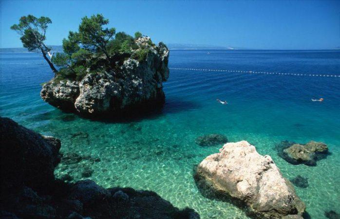 Lonely island along Makarska Riviera shoreline